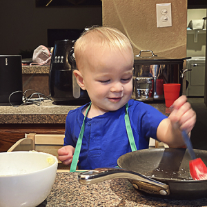 Baby in the kitchen cooking