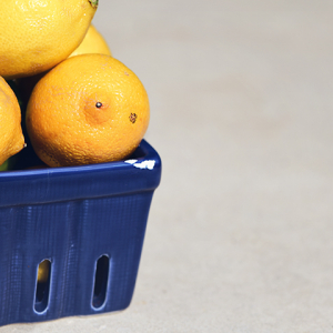 Lemons in chipped blue market basket