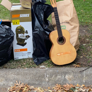 Trash pile with guitar